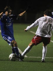 Covington Catholic Nathan Deimling plays the ball against Daviess County Nov. 5, 2016.