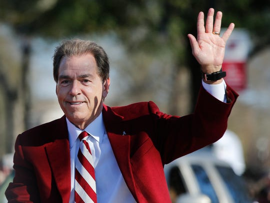 Alabama's coach Nick Saban waves to fans as he parades down the street during the NCAA college football national championship parade, Saturday, Jan. 20, 2018, in Tuscaloosa, Ala. Alabama won the national championship game against Georgia 26-23 in overtime.