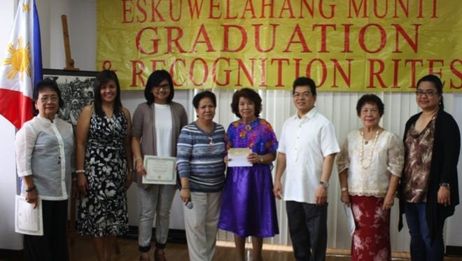 The University of Santo Tomas Alumni Association headed by its President, Veronica Alave (fourth from left) donated $500 to Eskuwelahang Munting Guam Principal Mila Moguel. The donation was witnessed by Consul General Marciano R. de Borja (third from right) and other UST Alumni members.