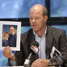 In this Aug. 14, 2014, file photo, attorney Paxton Guymon holds a photograph of Jim and Jan Harding during a news conference in Salt Lake City. Jan Harding, 67, who nearly died after unknowingly drinking iced tea mixed with chemicals has been released from a Salt Lake City hospital. Harding has been slowly improving since Aug. 10, when she drank a single sip of sweetened iced tea at Dickey's Barbecue in South Jordan, a Salt Lake City suburb. (AP Photo/Rick Bowmer, File)