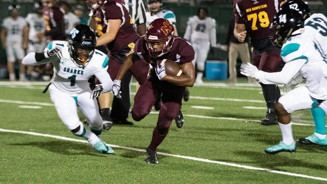 New Hampstead's Noddy Thomas runs for a gain in a loss to Islands on Nov. 6 as John Dickerson (No. 1) gives chase.