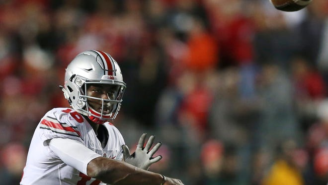 Ohio State quarterback J.T. Barrett (16) throws a pass during an NCAA college football game against Rutgers Saturday, Oct. 24, 2015, in Piscataway, N.J. (AP Photo/Mel Evans)