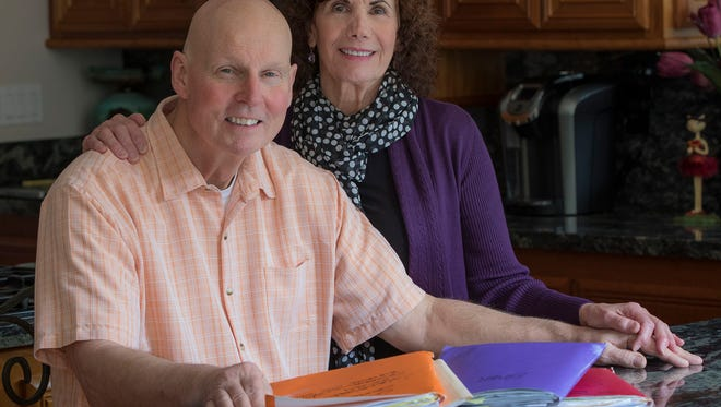 John Krahne, a lung cancer patient, and his wife, Audrey, sit in their kitchen in their home in Santa Rosa, Calif., on Feb. 21, 2017.