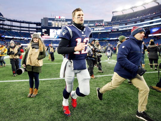 Tom Brady runs off of the field after defeating the Chargers to advance to the AFC championship game.