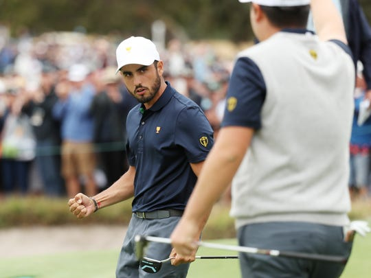 Abraham Ancer and Sungjae Im celebrate defeating Xander Schauffele of the United States team and Patrick Cantlay of the United States team 3&2 during Saturday four-ball matches on day three of the 2019 Presidents Cup at Royal Melbourne Golf Course on December 14, 2019 in Melbourne, Australia. (Photo by Rob Carr/Getty Images)