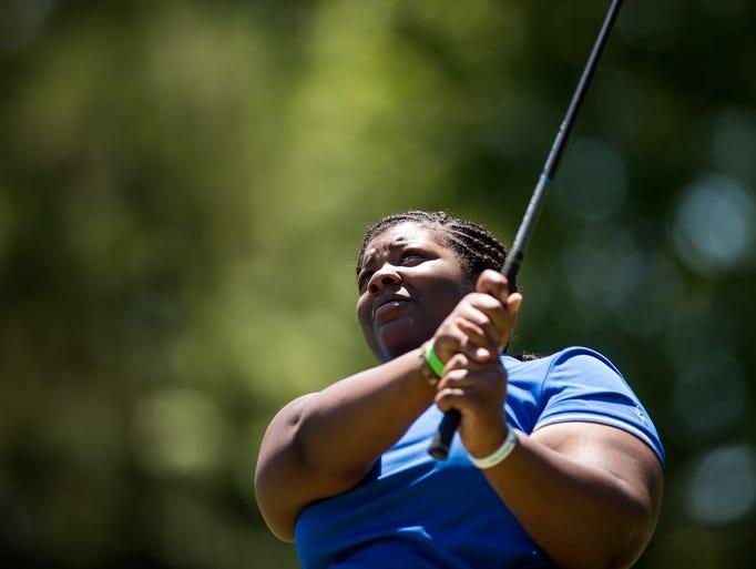 Tyra Robinson, 17, of Miami, Fla. eyes the ball while