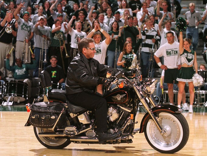 Michigan State basketball coach Tom Izzo rides a motorcycle
