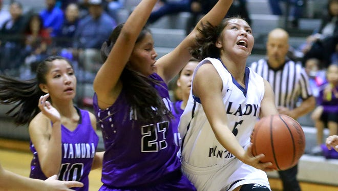 Piedra Vista's Alexis Long attempts a layup against Miyamura on Saturday at the Jerry A. Conner Fieldhouse.