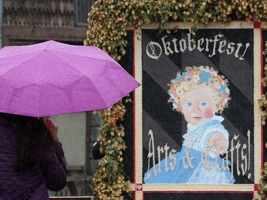 Festivalgoers brave the rain during the 51st Mount Angel Oktoberfest on Saturday, Sept. 17, 2016. The four-day festival, which celebrates the harvest, features live music, Bavarian-style food and beer.