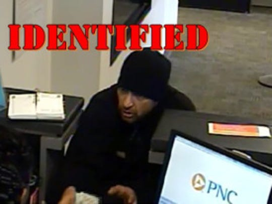 Police say this man, captured in a bank surveillance video, is David Tyre, 35, of Harrington and a suspect in Thursday's armed robbery at a PNC bank branch in Milford.