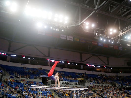Chris Brooks competes on the parallel bars during a the U.S men's Olympic gymnastics trials, Thursday, June 23, 2016, in St. Louis. (AP Photo/Tony Gutierrez)