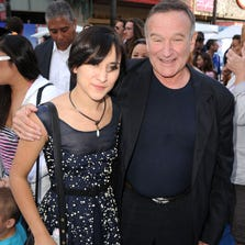 """Actress Zelda Williams and actor Robin Williams attend the Premiere of Warner Bros. Pictures' """"Happy Feet Two"""" at Grauman's Chinese Theatre on November 13, 2011 in Hollywood, California."""