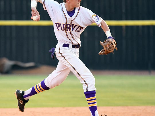 Purvis' Dakota Lee leaps throws to first base in a home game against Poplarville on Tuesday, April 3, 2018.