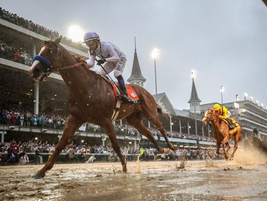 Justify, with Mike Smith aboard, wins the 144th running