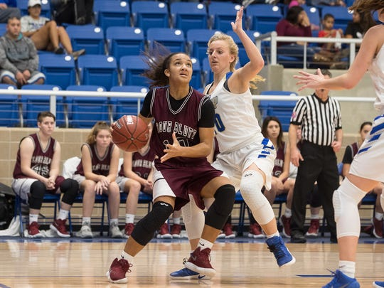 Flour Bluff's Hayle Campbell drives the ball to the basket past Kerrville's Julia Becher during the second half of the Region IV-5A girls final at the Northside Sports Gym in San Antonio on Saturday, Feb. 24, 2018.