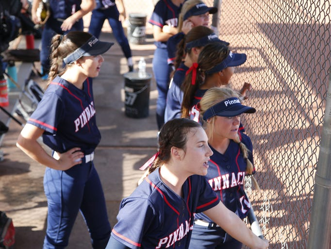 Pinnacle dugout cheers for a batter during a high school
