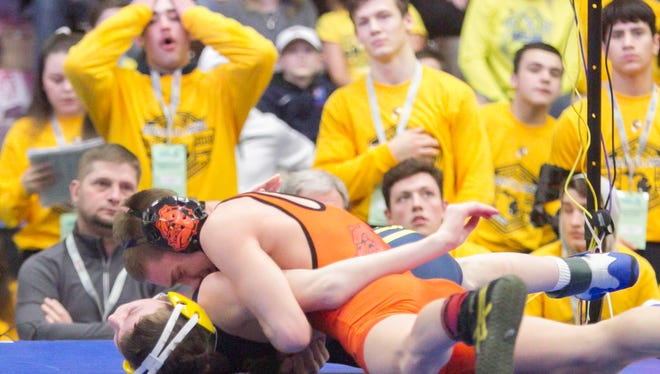 Brighton's Eddie Homrock nearly pins Bryce Cheney of Hartland in the 125-pound class of the state quarterfinals in Kalamazoo Friday, Feb. 23, 2018.