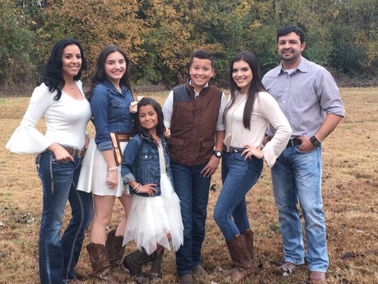 Marlon Martinez and members of his family pose for