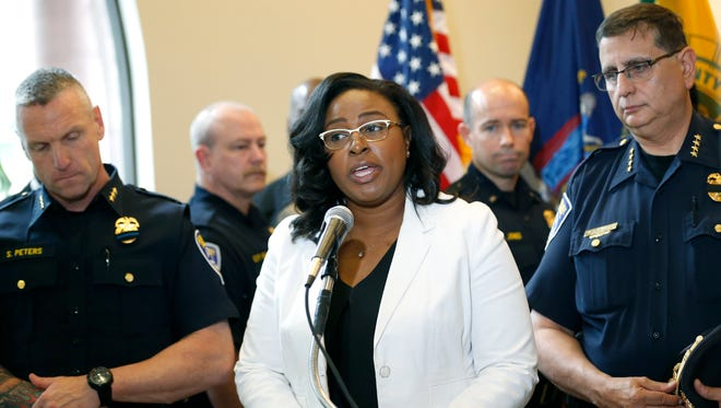 Mayor Lovely Warren and Police Chief Michael Ciminelli react to the Dallas police officers shootings and other shootings around the U.S. during a news  conference Friday at City Hall.