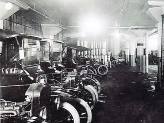A lineup of old Fords inside the old assembly plant,