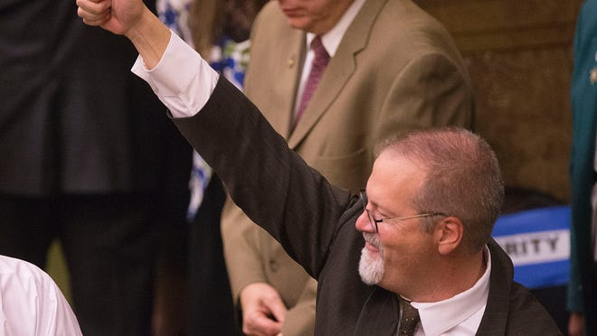 State Sen. Stephen Urquhart, gives a thumbs up after the Utah House of Representatives voted on and passed SB296 Wednesday, March 11, 2015, anti-discrimination bill.