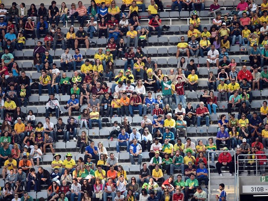 Empty seats scattered in the stands of the stadium during the group F World Cup soccer match between Iran and Nigeria at the Arena da Baixada in Curitiba, Brazil, Monday, June 16, 2014.  (AP Photo/Martin Meissner)