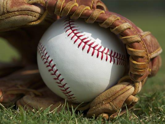 636285888977386052-baseball-glove-grass.jpg