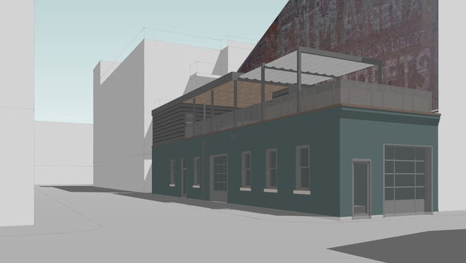 A rendering of the proposed Crown & Key bar development at 1332 Republic St. The current one-story garage at the southeast corner of 14th and Republic streets would be renovated and a nine-foot-tall deck would be built on top of the structure. Lang Thang Group, which would operate the Crown & Key Bar, said adding the deck would double the amount of space the establishment could use.