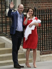 Prince William and Duchess Kate of Cambridge wave as
