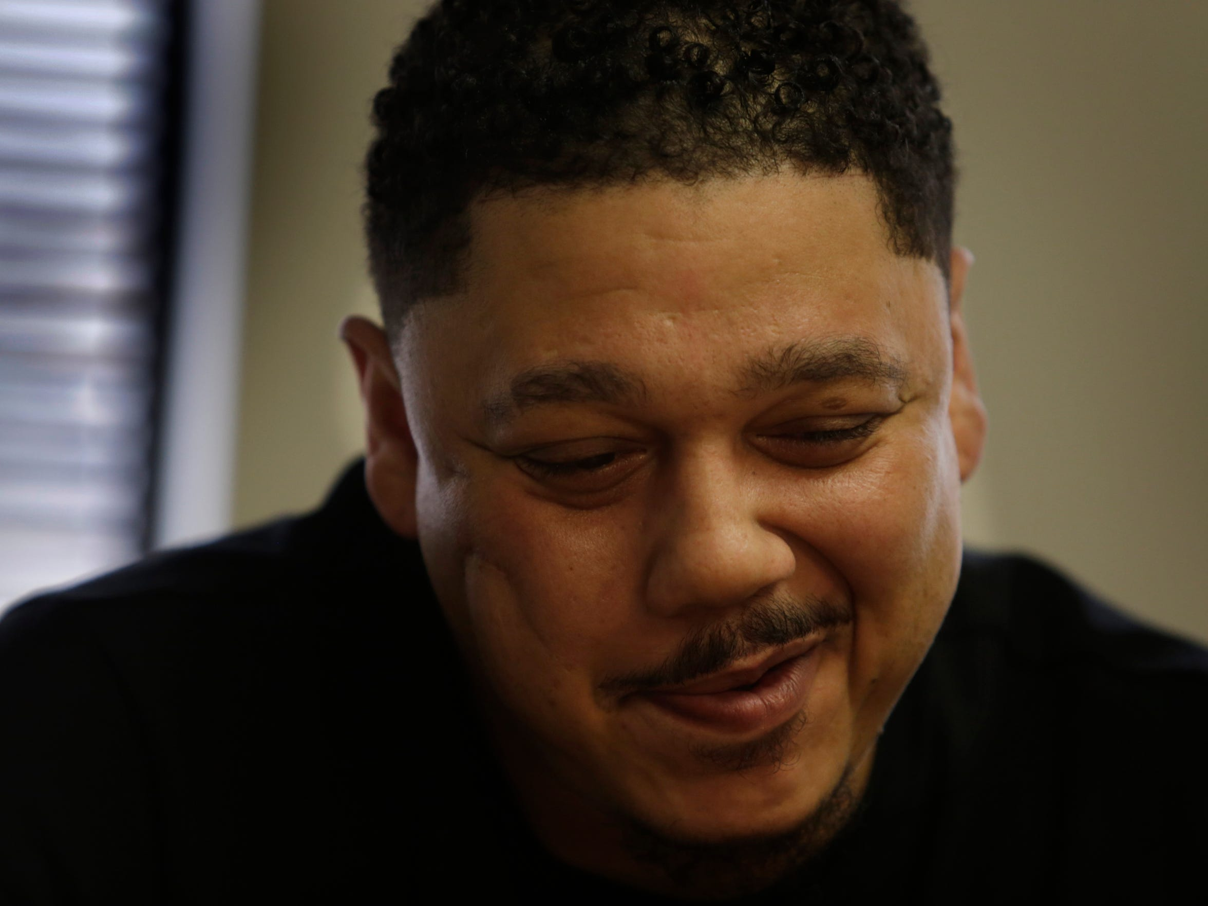 Detroit's Lamar McGaughy, 38, smiles as he speaks about his two children during a meeting at the Detroit Center for Family Advocacy in January.