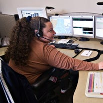 Cincinnati Fire Dispatcher Cara Van Steelandt takes emergency calls and dispatches Cincinnati fire companies in Price Hill, on a system based in Colerain Township at the Hamilton County Communications Center.