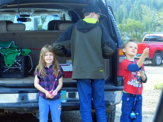 Two young anglers prepare to catch a big one at the Annual Kids Fishing Day at Grindstone Lake in Ruidoso.