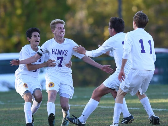 Ryan Euell, center, celebrates with his Rhinebeck High School teammates during their game against Spackenkill on Oct. 15.