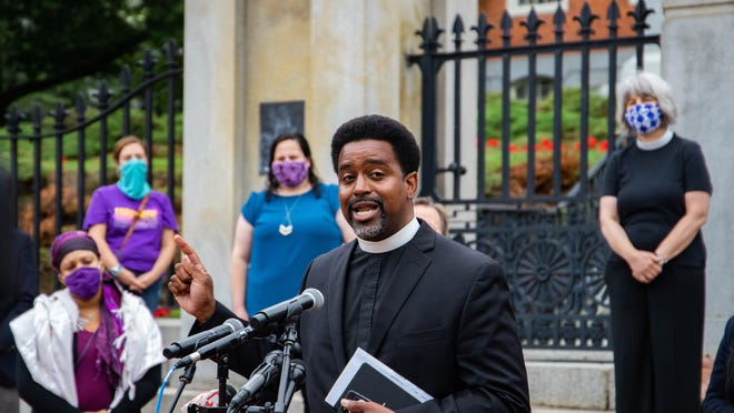 Rev. Rahsaan Hall, the racial justice program director at ACLU Massachusetts, speaks outside the State House on Friday.