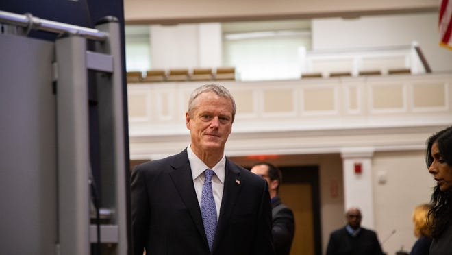 Gov. Charlie Baker walks off after a recent press conference.