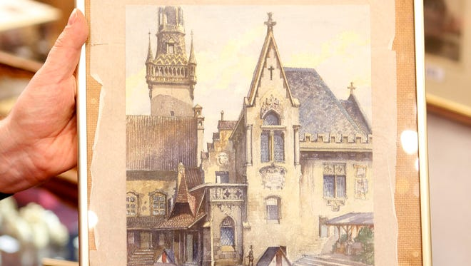 """A picture titled  """"The Old City Hall"""" that - as the auction house said - was painted by Adolf Hitler is displayed in an auction house in Nuremberg, Germany."""