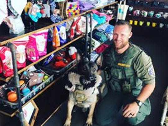 Wichita County Sheriff's Office Corp. Josh Brown and K-9 Officer Kimbo are seen  at Frank and Joe's Coffee Shop, one of their favorite places. Kimbo will have a retirement party at Frank and Joe's at a later date.