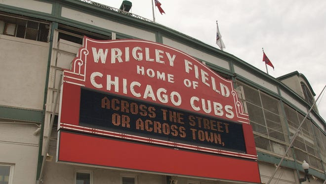 CHICAGO - JUNE 15: (FILE PHOTO) General view of the exterior of the Chicago Cubs home field of Wrigley Field in Chicago, Illinois on June 15, 2004. It was reported that Tribune Co. has finalized a deal to sell the Chicago Cubs along with Wrigley Field to the Ricketts family for a sale price of close to $900 million July 6, 2009.  (Photo by: Getty Images) GTY ID: 60922CP005_WRIGLEY_FIELD