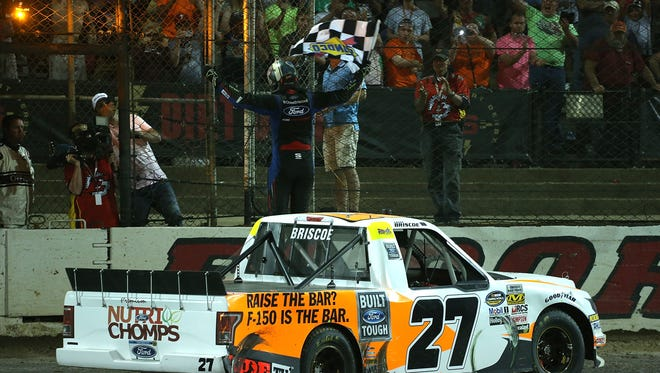 Chase Briscoe celebrates with the checkered flag after winning the NASCAR Camping World Truck Series Eldora Dirt Derby at Eldora Speedway.