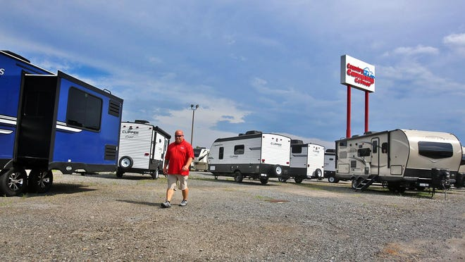 Damien Gray walks through empty camper parking spaces while taking inventory at County Camping Corner in Kings Mountain on Wednesday.