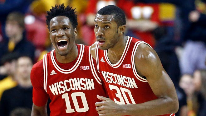 Wisconsin's Nigel Hayes, left, reacts after Vitto Brown, right, scored against Maryland on Feb. 13, 2016, in College Park, Md. Wisconsin won, 70-57.