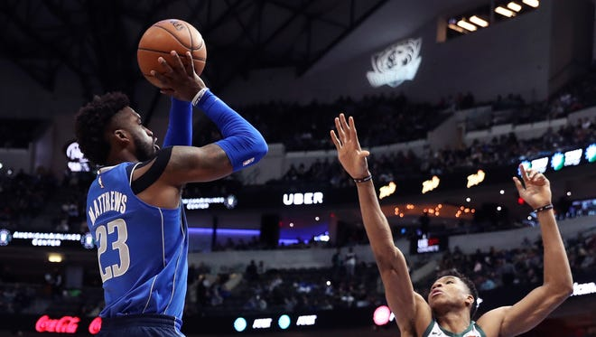 Wesley Matthews of the Mavericks gets ready to launch a three-pointer over Giannis Antetokounmpo of the Bucks on Saturday night in Dallas.
