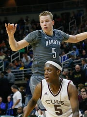 Macomb Dakota's Thomas Kithier plays against U-D Jesuit