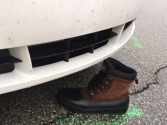 Greenwood Officer Scott Cottongim's boot was knocked