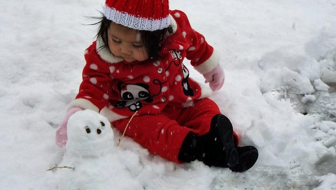 Aidalina Carabajal, 7 months old, experiences snow for the first time. To see other reader-submitted photos of Saturday's winter storm in the Mesilla Valley, log on to lcsun-news.com.
