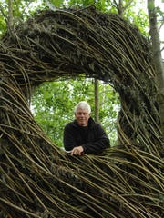 North Carolina-based sculptor Patrick Dougherty with one of his installations. Doughtery is beginning a three week residence at Blackfoot Pathways: Sculpture in the Wild in Lincoln.