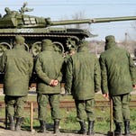 Russian soldiers unload trainload of their modified T-72 tanks after their arrival in Gvardeyskoe railway station near the Crimean capital Simferopol, on March 31, 2014. The Crimean crisis has sparked the most explosive East-West confrontation since the Cold War and fanned fears in Kiev that Russian President Vladimir Putin now intends to push his troops into southeast Ukraine.  AFP PHOTO / OLGA MALTSEVAOLGA MALTSEVA/AFP/Getty Images ORG XMIT: - ORIG FILE ID: 528542473