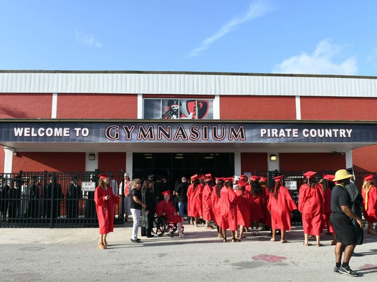 Students from Palm Bay Magnet High school receive their diplomas in ceremonies Saturday morning.