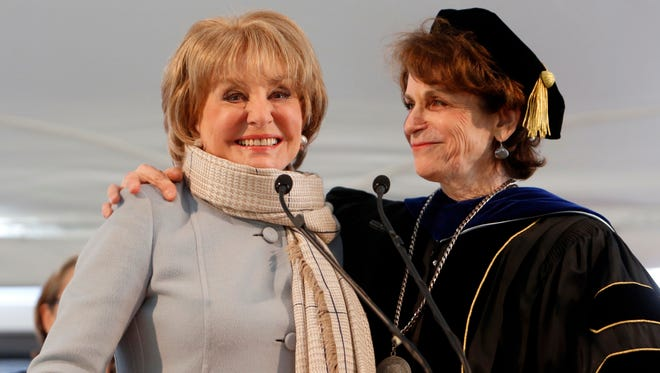President Karen R. Lawrence welcomes surprise guest, alumna Barbara Walters, at the Sarah Lawrence College graduation, May 23, 2014 in Yonkers.