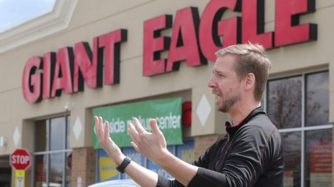 Giant Eagle spokesman Dan Donovan in front of the Howe Avenue Giant Eagle in April. An employee at teh Portage Crossing store recently tested positive for the coronavirus, the chain announced.